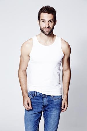 Man in vest smiling at camera, portrait Standard-Bild