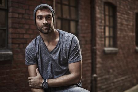 Urban dude in grey t-shirt, portrait Stock Photo