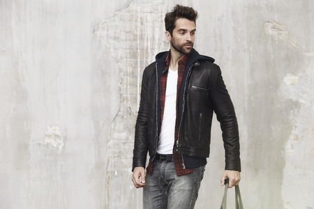 undone: Dude in leather jacket, looking away Stock Photo