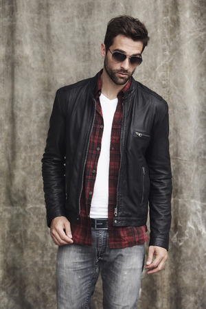undone: Dude in shades and leather jacket, portrait Stock Photo