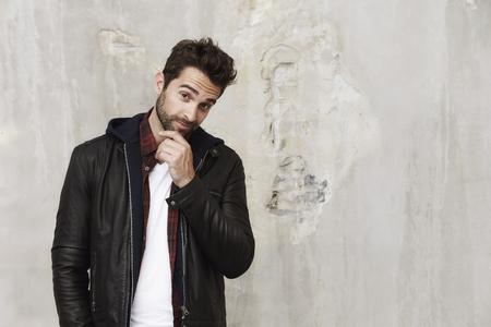 undone: Thoughtful dude in leather jacket, portrait Stock Photo