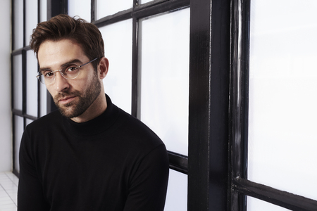 bookish: Bookish dude in black sweater and glasses, portrait