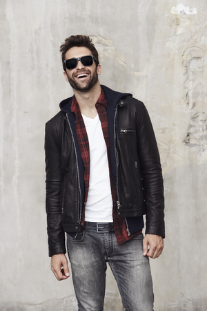 undone: Laughing dude in leather jacket, studio