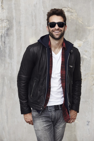 Sunglasses and leather dude in studio, portrait