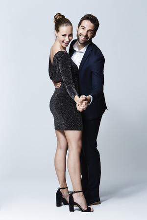 Stunning couple dancing in studio, portrait Standard-Bild