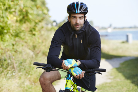 Seriously cycling man in helmet, portrait Stock Photo