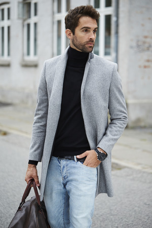 Handsome city guy looking away Standard-Bild