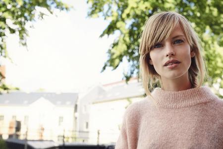 Blue eyed beautiful blond woman in portrait Stock Photo