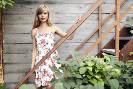 Girl in summer dress looking at camera Stock Photo