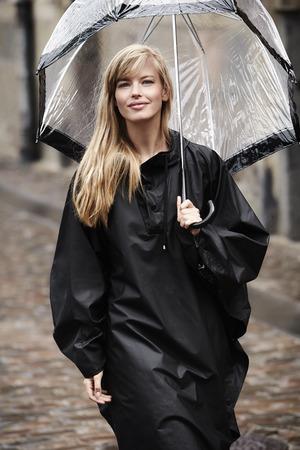 Stylish girl with umbrella in black, portrait
