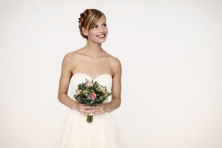 Stunningly beautiful bride against white background Stock Photo