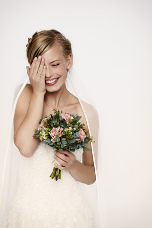 embarrassment: Laughing bride in white wedding dress Stock Photo