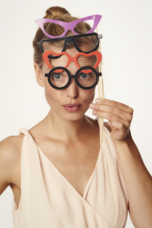 Beautiful woman wearing pairs of comedy glasses Stock Photo