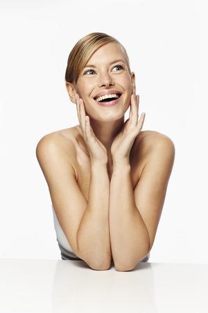 Surprised and stunning blond woman, studio Stock Photo