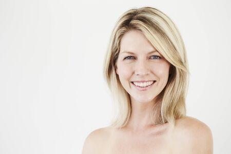 Pretty smile on beautiful blond woman, studio Stock Photo