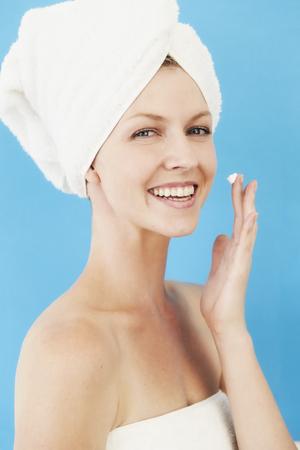 Beauty regime for beautiful woman in towel, portrait