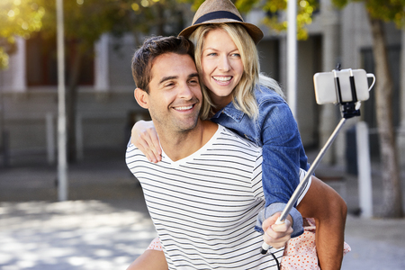 Smiling happy couple messing about for selfie