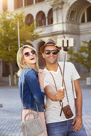 Tourist couple on city break taking selfie Stock Photo