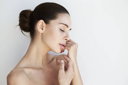 Beautiful brunette woman serene against white background