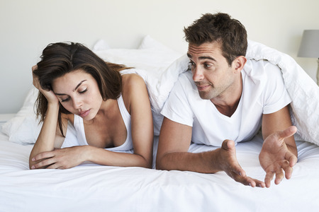 Couple with relationship problems in bed