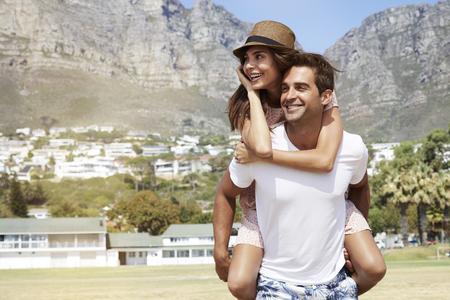 Couple having fun in sun, smiling Stock Photo