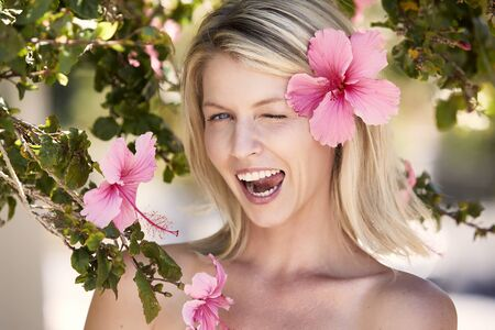 Beautiful winking flower babe looking at camera