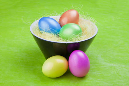 Colorful Easter eggs on a green background