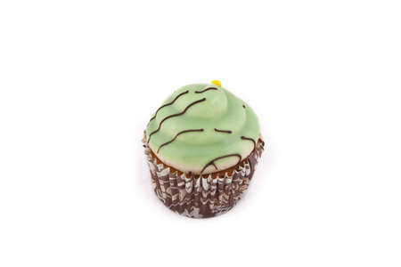 Delicious apple flavoured cupcake with green topping, on a white background Stock Photo