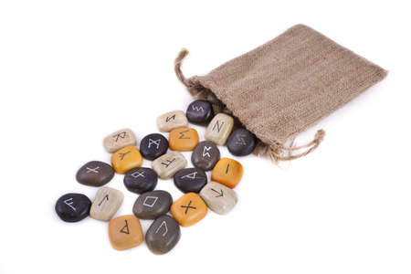 Rune Stones on white background, with a jute bag photo