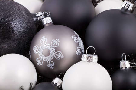 Black, white and taupe coloured Christmas decorations  ornaments
