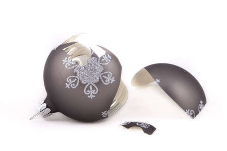 Broken, taupe coloured Christmas ornament Stock Photo