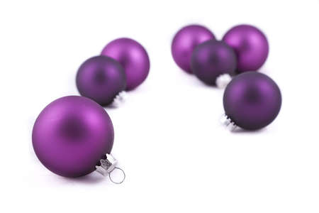 Purple christmas balls or decorations, on white background