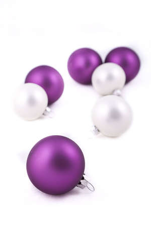 Purple and white christmas balls or decorations, on white background