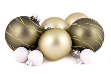 Green and white christmas balls or decorations, on  a white background, with shallow depth of field