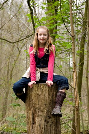 young blonde girl is climbing  in trees Stock Photo - 4956647