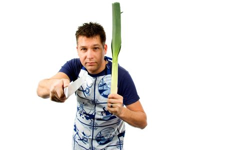 intimidating: cook is intimidating with leek and knife, isolated on white background