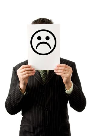 misery: Businesman is holding a sad smilie