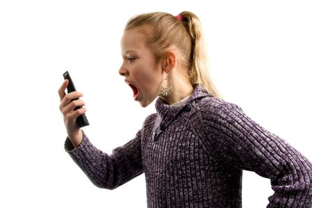Girl is angry at her phone isolated on white background Stock Photo - 4978682