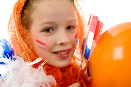 Young girl is posing in orange with balloon and flag, isolated on white  photo
