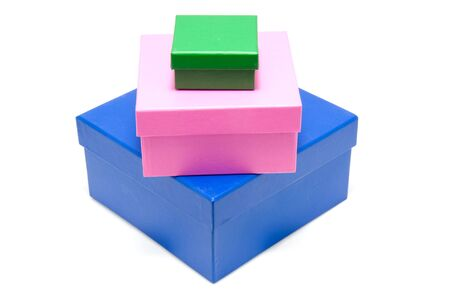stacked colorful boxes isolated on white background photo