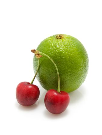 cherries and lime isolated on white background photo