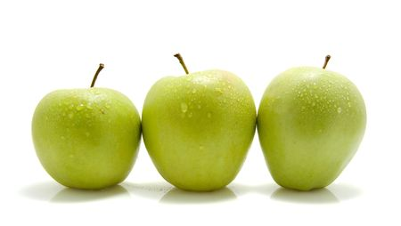 three juicy green apples isolated on white background photo