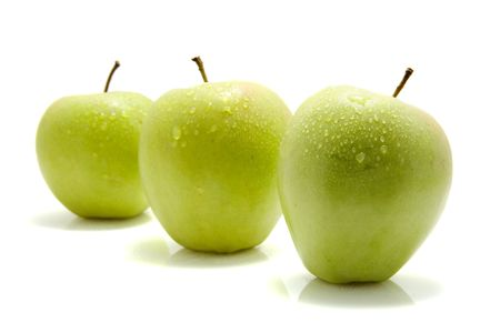 three juicy green apples isolated on white background Stock Photo - 5120159