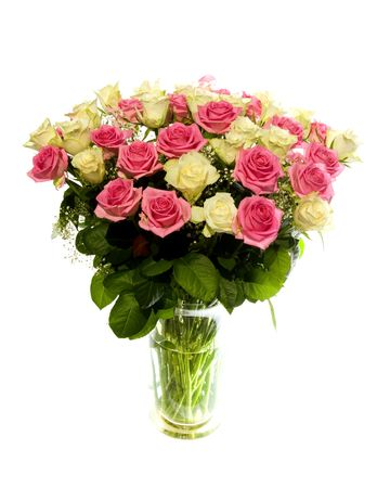 Bouquet of beautiful roses with gypsum herb in glass vase