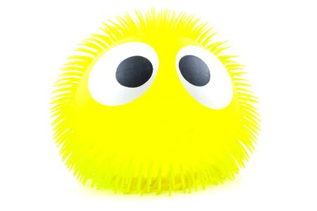 squint: Funny yellow face with big eyes in closeup over white background
