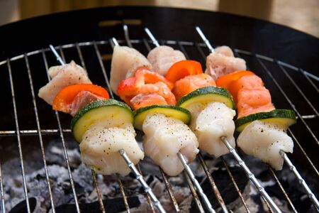 seafruit: delicious fish spear grilling on barbecue