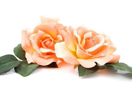 counterfeiting: Silk orange roses isolated on white background Stock Photo
