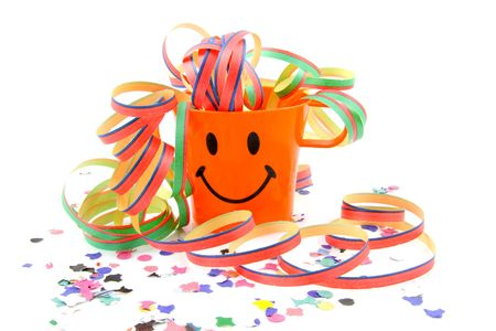 Orange party cup with streamers and confetti over white background photo