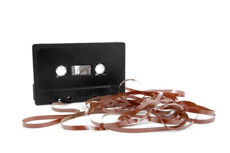 messed: Messed up audio cassette tape isolated on white