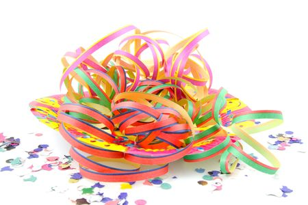 Colorful party streamers and conetti isolated on white background photo